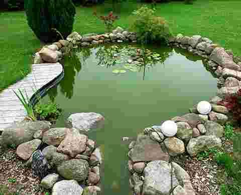 stones and garden surrounding water